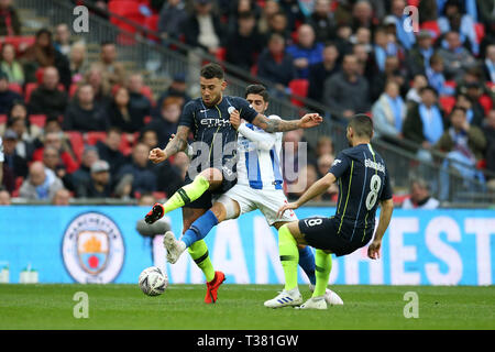 London, UK. 06th Apr, 2019. Nicolas Otamendi of Manchester city (l) in action. The Emirates FA Cup, semi-final match, Manchester City v Brighton & Hove Albion at Wembley Stadium in London on Saturday 6th April 2019.  this image may only be used for Editorial purposes. Editorial use only, license required for commercial use. No use in betting, games or a single club/league/player publications . Credit: Andrew Orchard sports photography/Alamy Live News - Stock Photo