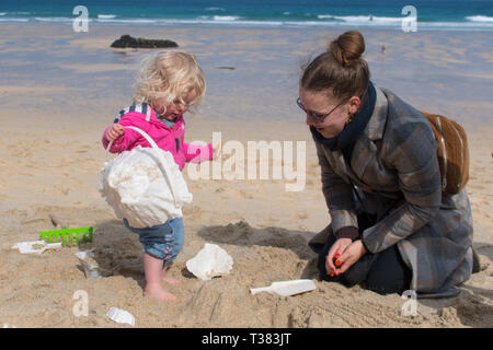 St Ives, Cornwall, UK. 7th April 2019. The public were invited to cover the beach at St Ives with tiny mountains, made from moulds to represent Mount Kilmanjaro,  Shasta, Fuji, Stromboli and Ulura. The event today organised by the Tate St Ives is one of several taking place around the UK in conjunction with artist Katie Paterson. Credit: Simon Maycock/Alamy Live News - Stock Photo