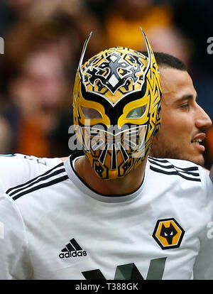 London, UK. 07th Apr, 2019. Wolverhampton Wanderers' Raul Jimenez celebrates scoring his sides second goal with a Wolves Mask during The FA Emirates Cup Semi-Final match between Watford and Wolverhampton Wanderers at Wembley Stadium, London, UK on 07 Apr 2019. Credit: Action Foto Sport/Alamy Live NewsEditorial use only, licence required for commercial use. No use in Betting, games or a single club/league/player publication. Credit: Action Foto Sport/Alamy Live News - Stock Photo