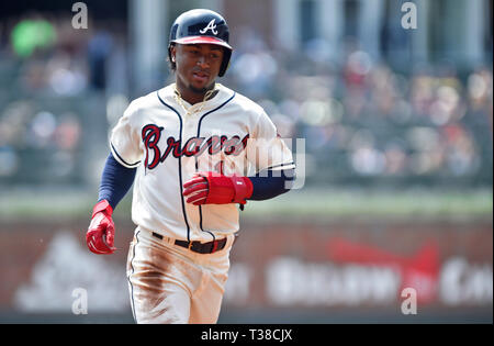 Atlanta, GA, USA. 7th Apr, 2019. Atlanta Braves infielder Ozzie Albies rounds third base on his way to home off a Freddie Freeman home run during the first inning of a MLB game against the Miami Marlins at SunTrust Park in Atlanta, GA. Austin McAfee/CSM/Alamy Live News - Stock Photo