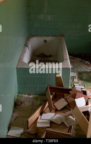 Close up of a bathtub in an abandoned house - Stock Photo