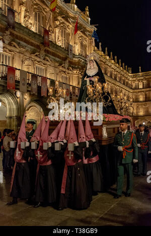 Salamanca, Spain; March 2017: Brotherhood of Our Father Jesus Flagelado and Our Lady of Tears, parading the night of Holy Wednesday in the main square - Stock Photo