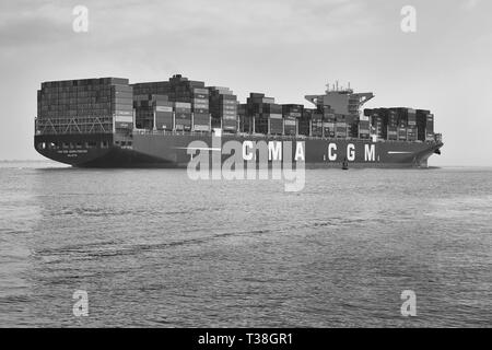 Black And White Photo Of The Container Ship, CMA CGM GEORG FORSTER, Entering A Bank Of Sea Fog As She Departs Southampton, UK. 28 March 2019. - Stock Photo