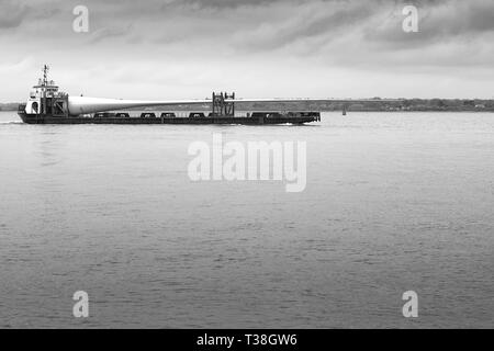Black and White Photo Of The 75 Metre Long VESTAS BLADES UK LTD, MTB BLADE RUNNER TWO, Deck Cargo Ship, Departing Southampton Harbour, Hampshire, UK. - Stock Photo