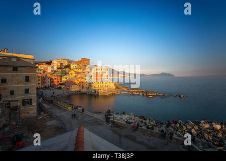GENOA, ITALY, MARCH 23, 2019 - View of Genoa Boccadasse at sunset,  a fishing village with colorful houses in Genoa, Italy. - Stock Photo