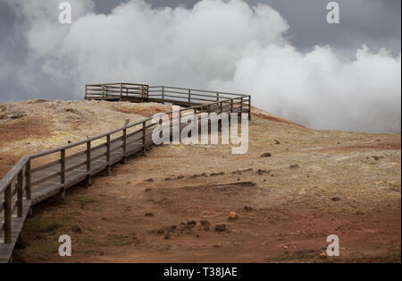 Iceland geothermal. Namafjall - area in field of Hverir. Landscape which pools of boiling mud and hot springs. Tourist and natural attractions - Stock Photo