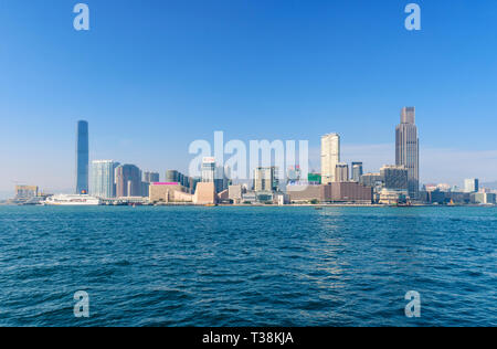Skyline of Kowloon with Tsim Sha Tsui waterfront in the foreground. Victoria Harbour, Hong Kong - Stock Photo