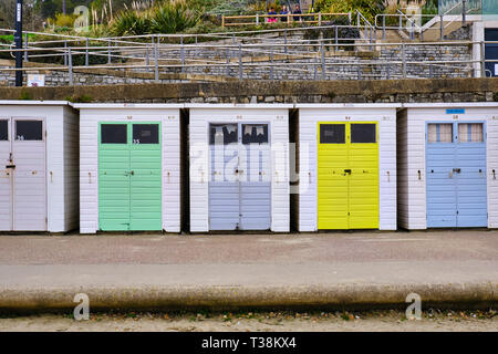 Pictured are beach huts at the Cobb Harbour, Lyme Regis, Dorset. - Stock Photo