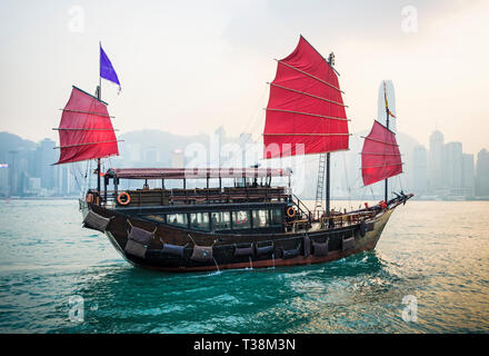 Hong Kong Junk boat in Victoria Harbour, the Aqualuna sunset sailing, Victoria Harbour, Hong Kong - Stock Photo