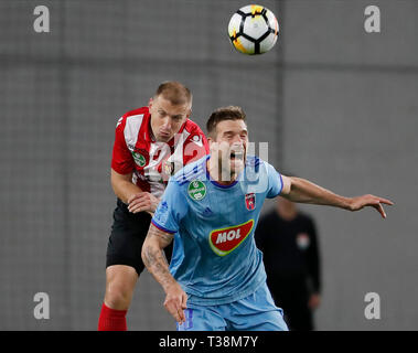 BUDAPEST, HUNGARY - APRIL 6: (l-r) Djordje Kamber of Budapest Honved battles for the ball in the air with Marko Futacs of MOL Vidi FC during the Hungarian OTP Bank Liga match between Budapest Honved and MOL Vidi FC at Nandor Hidegkuti Stadium on April 6, 2019 in Budapest, Hungary. - Stock Photo