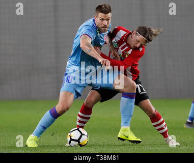 BUDAPEST, HUNGARY - APRIL 6: (l-r) Marko Futacs of MOL Vidi FC competes for the ball with Gergo Nagy of Budapest Honved during the Hungarian OTP Bank Liga match between Budapest Honved and MOL Vidi FC at Nandor Hidegkuti Stadium on April 6, 2019 in Budapest, Hungary. - Stock Photo