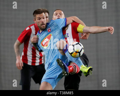 BUDAPEST, HUNGARY - APRIL 6: (l-r) Marko Futacs of MOL Vidi FC fights for the ball with Djordje Kamber of Budapest Honved during the Hungarian OTP Bank Liga match between Budapest Honved and MOL Vidi FC at Nandor Hidegkuti Stadium on April 6, 2019 in Budapest, Hungary. - Stock Photo