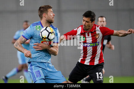 BUDAPEST, HUNGARY - APRIL 6: (l-r) Marko Futacs of MOL Vidi FC competes for the ball with Tibor Heffler of Budapest Honved during the Hungarian OTP Bank Liga match between Budapest Honved and MOL Vidi FC at Nandor Hidegkuti Stadium on April 6, 2019 in Budapest, Hungary. - Stock Photo