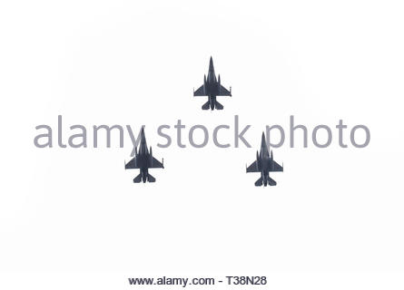 Squadron of military planes compound of three modern fighter jets isolated. Concept of war, air defense and attack. Plane formation. - Stock Photo