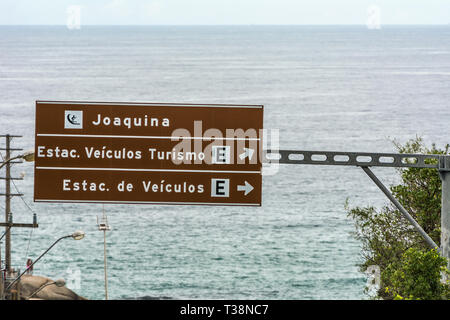 2019, January. Florianopolis, Brazil. Traffic sign in front of Joaquina Beach. - Stock Photo