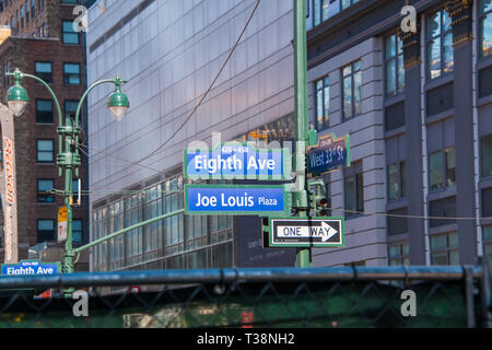 New York, NY - April 3, 2019: Street signs on a pole in New York City. Eight Avenue and 33rd street. Joe Lewis Plaza - Stock Photo