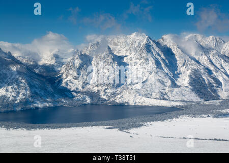 An aerial view of Jenny Lake below Cascade Canyon and Hanging Canyon in the Teton Mountains. Grand Teton National Park, Wyoming - Stock Photo