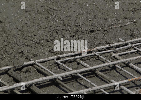 cement on metal formwork - Stock Photo