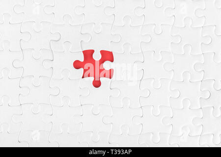 White blank jigsaw puzzle without one piece. Missing part and incompleteness theme - Stock Photo