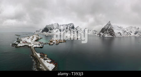 Aerial point of view of Lofoten.  Drone panorama landscape of Reine and Hamnoy fishing villages with fjords and mountains in the background in Norway.