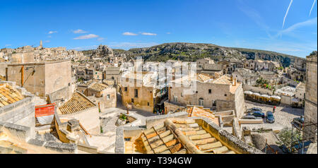 Panoramic shot of the steep cliffs and canyon sassi caves, the ancient Madonna de Idris rock church and the  city of Matera, Italy. - Stock Photo