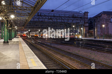 A Class 73 locomotive at Glasgow Central station waiting to depart with new caledonian sleeper carriages after they completed a test run from London - Stock Photo