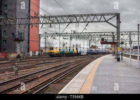 The  2353 London Euston to Glasgow Central Caledonian sleeper train arriving at Glasgow central station after its overnight journey. - Stock Photo