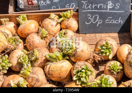 A wooden box of turnips for sale. - Stock Photo