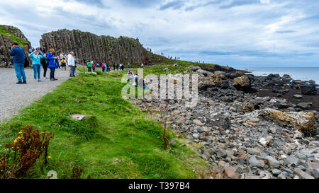 Tourists at the Giant's Causeway in Bushmills Northern Ireland. - Stock Photo
