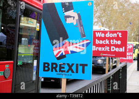 Anti-Brexit SODEM gun Union Jack shoe poster  'Shoot Yourself in the Foot'  outside Parliament in Westminster, London UK 4 April 2019  KATHY DEWITT - Stock Photo