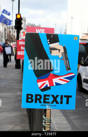 Brexit SODEM gun Union Jack shoe poster  'Shoot Yourself in the Foot'  outside Parliament in Westminster, London UK 4 April 2019  KATHY DEWITT - Stock Photo