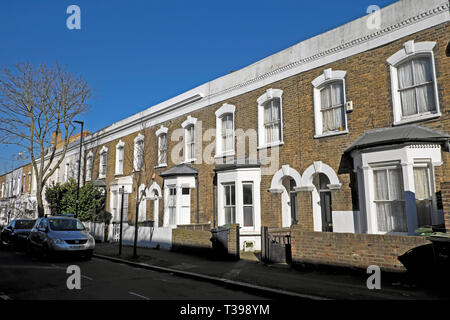 Row of terraced housing on Hargwyne Street in Brixton, South London SW9 England UK  KATHY DEWITT - Stock Photo