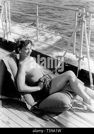 woman relaxing on ship, 1956 - Stock Photo