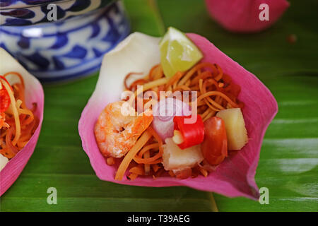 Closed Up Thai Style Fresh Lotus Flower Petal Wrapped Appetizer Called Miang kham - Stock Photo