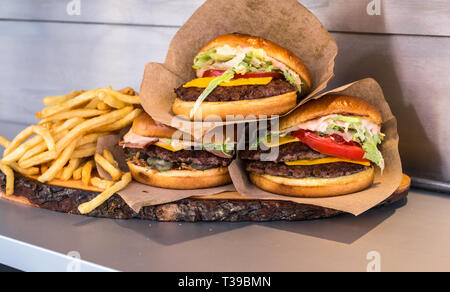 appetizing hamburger on the counter in the market - Stock Photo