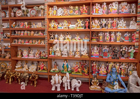 A large variety of statues of Hindu deities for sale at Maha Shakti, a store that sells religious items and ethnic clothing in Queens, New York. - Stock Photo