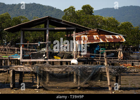 KO CHANG, THAILAND - APRIL 10, 2018: Authentic traditional fishermen's village on the island - People and children in their natural habitat with bikes - Stock Photo
