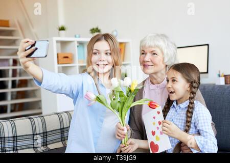 Women in Family Taking Selfie - Stock Photo