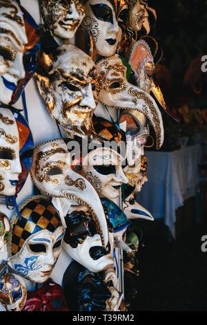 VENICE, ITALY - SEPTEMBER, 9 2018: Colorful venetian masks sale in store on street, Venice, Italy. Vintage Venetian mask carnival. - Stock Photo