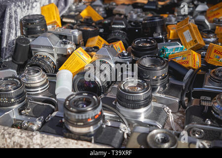 London, UK - November, 2018. Old Vintage cameras and lenses on sale in a stall in Portobello Road Market, the largest antiques market in the world. - Stock Photo