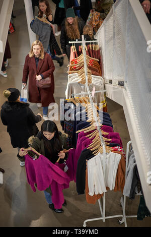 London, UK - November, 2018. People shopping in a design clothes store in central London during the Black Friday. - Stock Photo