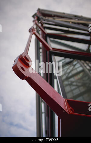 Detail of a steel joint on the façade of a modern building. Construction concept. Portrait format. - Stock Photo