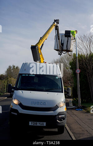 Fitting Energy efficient LED Lights in Edinburgh - Stock Photo