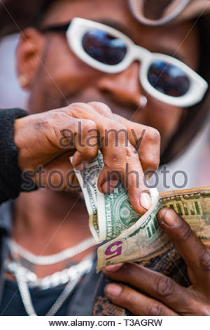 Daytona Beach, FL - 12 March 2016: Street performer with snake earning money at the 75th Annual Bike Week at the World's Most Famous Beach. - Stock Photo