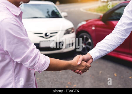 Customer shake hand with auto insurance agents examining car crash owner after agreeing find a friendly agreement after a car accident to terms of ins - Stock Photo