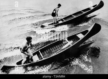 single-seater canoes carried out only by bending the knees, 1952 - Stock Photo