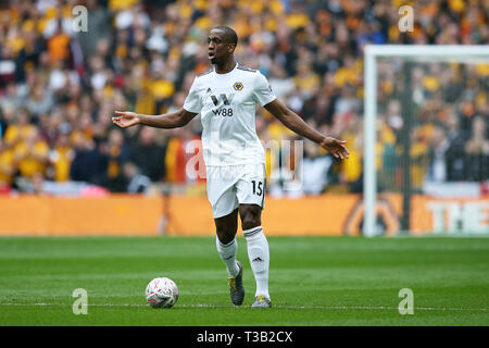 London, UK. 07th Apr, 2019. Willy Boly of Wolverhampton Wanders in action. The Emirates FA Cup, semi-final match, Watford v Wolverhampton Wanderers at Wembley Stadium in London on Sunday 7th April 2019. this image may only be used for Editorial purposes. Editorial use only, license required for commercial use. No use in betting, games or a single club/league/player publications . pic by Andrew Orchard/Andrew Orchard sports photography/Alamy Live news Credit: Andrew Orchard sports photography/Alamy Live News - Stock Photo