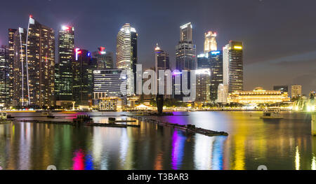 Singapore at night overlooking Downtown from Marina Bay Sands - Stock Photo