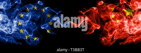 European Union vs China, Chinese smoke flags placed side by side. Thick colored silky smoke flags of EU and China, Chinese - Stock Photo