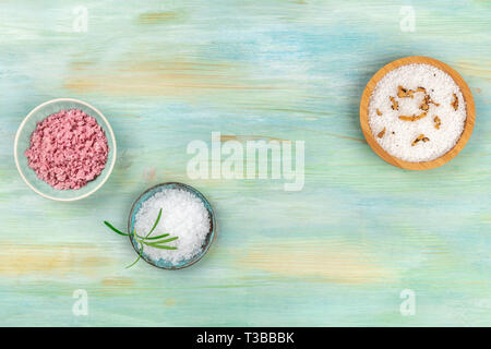 Gourmet spices. Various types of salt with different addings, shot from the top on a teal blue background with a place for text - Stock Photo